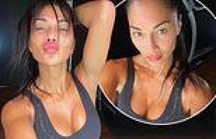 Nicole Scherzinger puts on a busty display in a black sports bra after workout