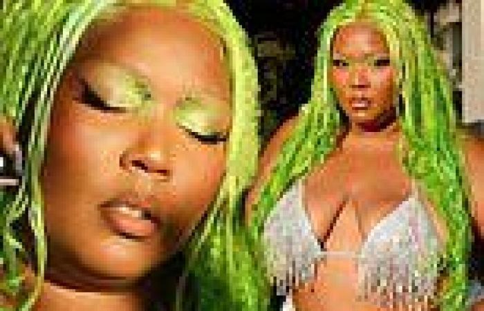 Lizzo models glittering metallic bra and 'slime green' hairdo