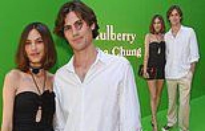 Alexa Chung lets loose in little black dress as she celebrates her ...