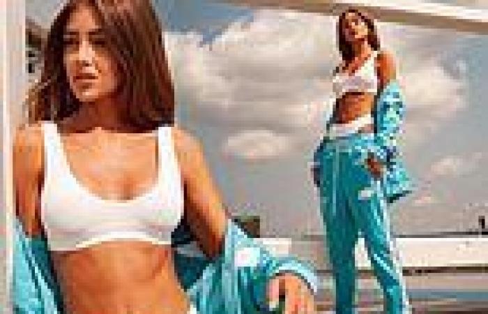 Love Island's Georgia Steel showcases her washboard abs in white lingerie