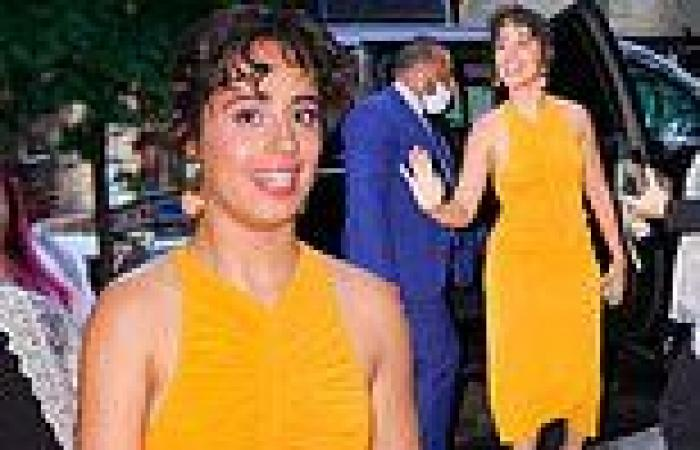 Camila Cabello makes a splash in bright orange dress as she swings by Jimmy ...