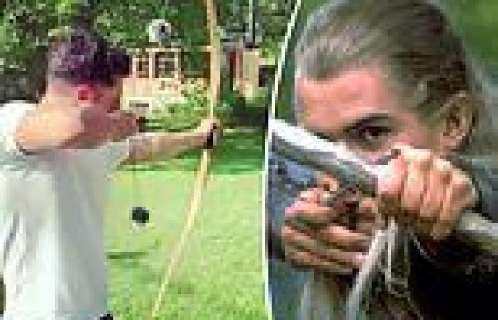 Orlando Bloom proves he's still a sure shot as he flexes his elfin archery ...