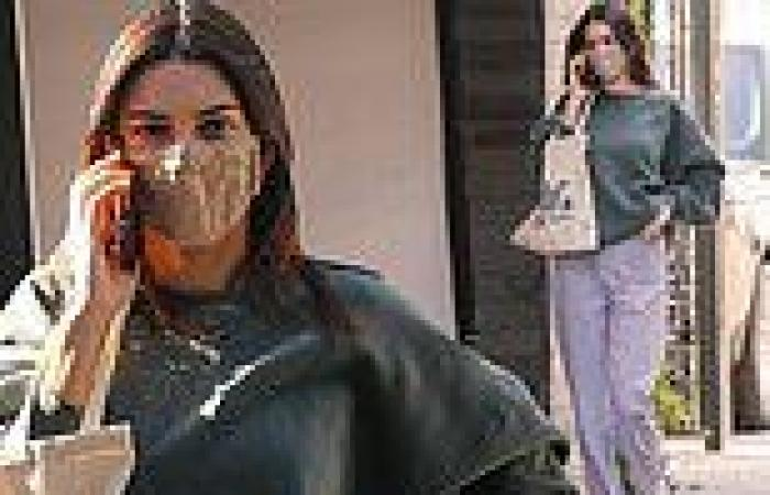 Kendall Jenner cuts a casual figure in sweats as she chats on the phone