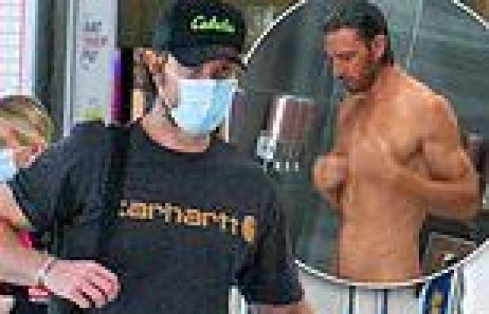 Netflix's Sex/Life actor Adam Demos covers up at Sydney Airport