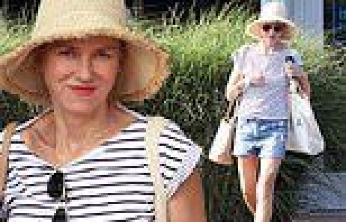 Naomi Watts beams and shows off her toned legs in denim shorts while shopping ...