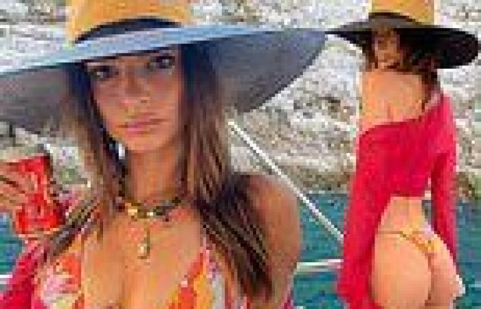 Emily Ratajkowski puts on a cheeky display in a skimpy bikini during a boat ...