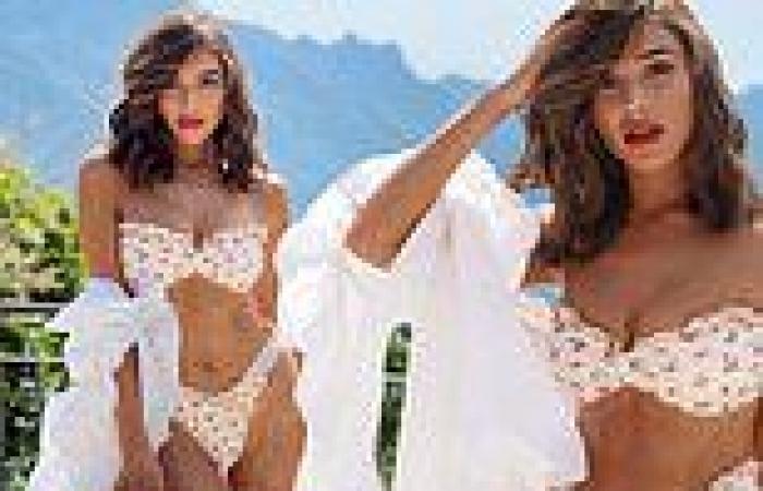 Olivia Culpo shows off her incredible figure in a cherry print bikini in Italy