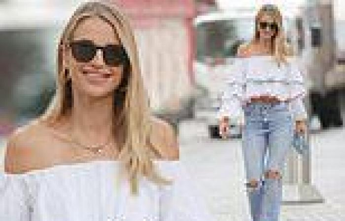 Vogue Williams looks typically stylish in a ruffled bardot blouse and jeans for ...
