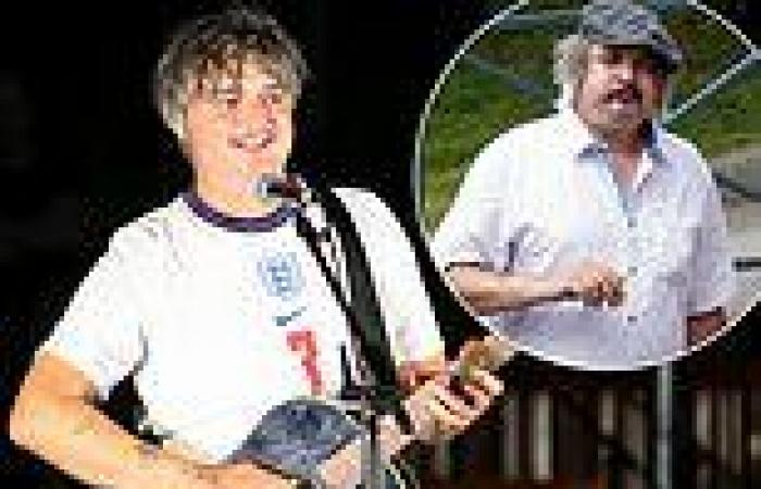 Pete Doherty flashes a broad smile as he shows off his slimmed-down frame on ...