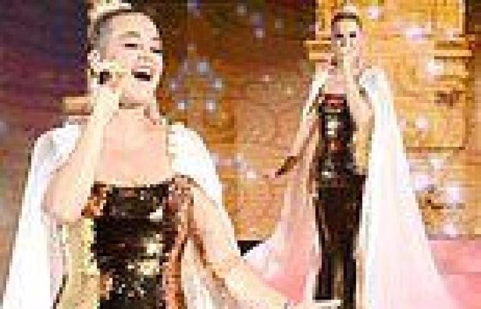 Katy Perry wows in a gold sequinned gown and billowing cape