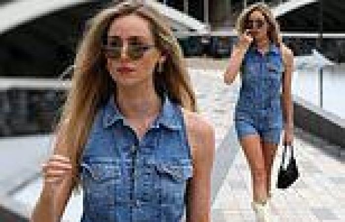 Diana Vickers cuts a stylish figure in a denim playsuit and white boots amid ...