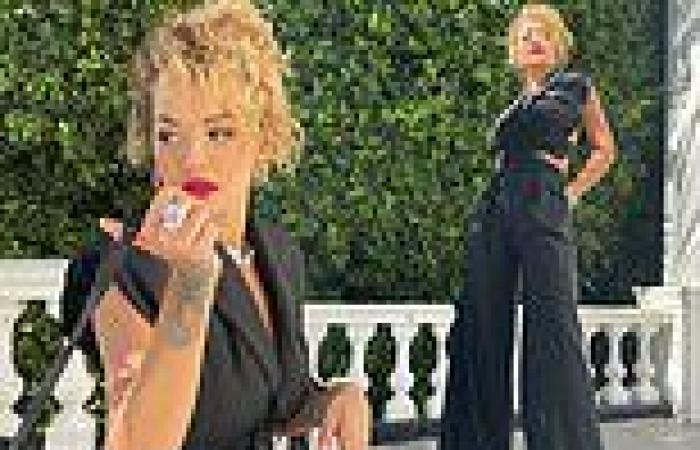 Rita Ora sports curly tresses and teases a glimpse of her taut abs in cut-out ...