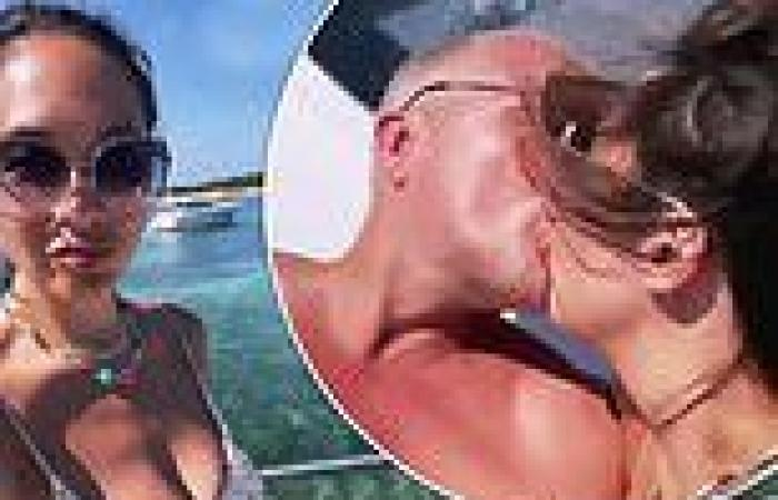Myleene Klass puckers up to fiancé Simon during family holiday