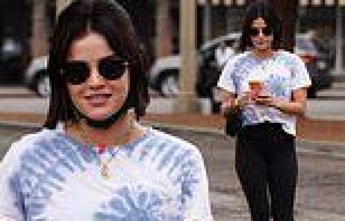 Lucy Hale sports a tie-dye t-shirt and figure-hugging leggings during morning ...