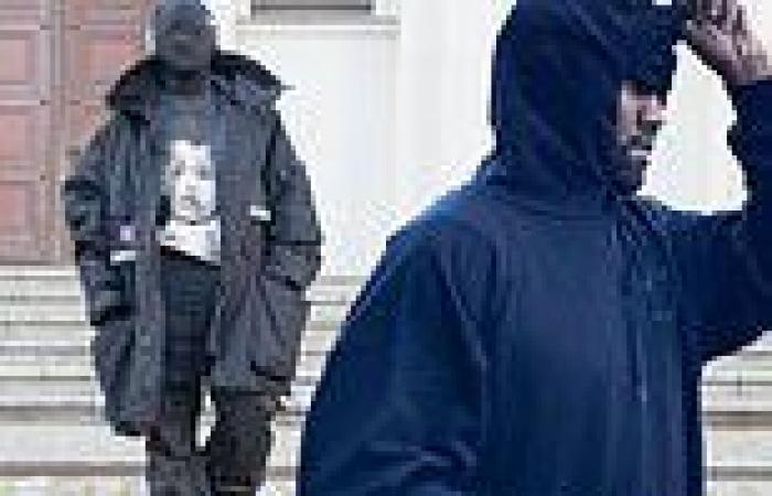 Kanye West dons disguise gallery hopping around Berlin... after hinting he ...