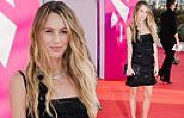 Dylan Penn puts on a leggy display in a tasselled black mini dress at a ...