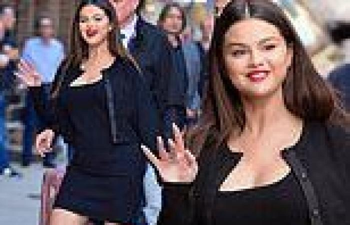 Selena Gomez looks like a bombshell donning a little black dress with a bold ...