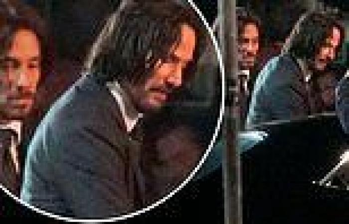 Keanu Reeves is seen filming John Wick 4 with his body double by his side in ...