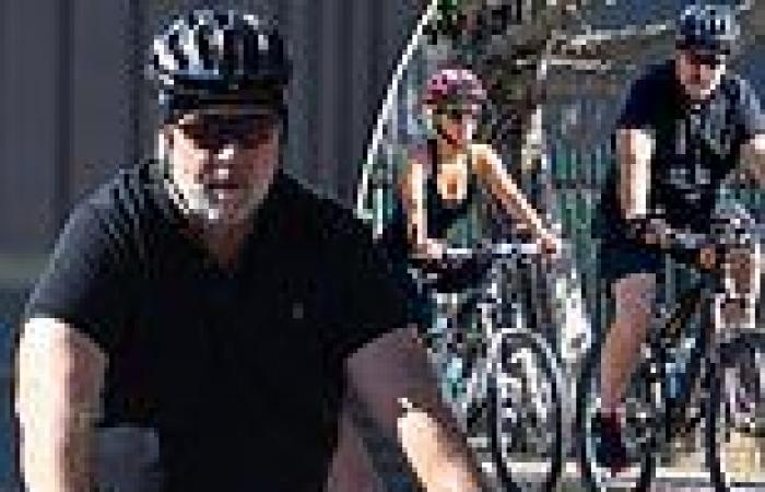 Russell Crowe and his girlfriend Britney Theriot enjoy a bike ride