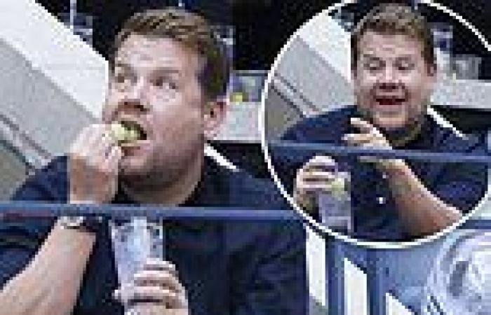 James Corden enjoys a Honey Deuce cocktail as he watches the U.S. Open men's ...