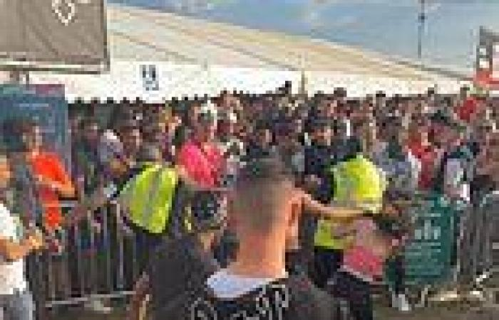 Shocking moment security guard slaps woman to the ground during brawl at ...