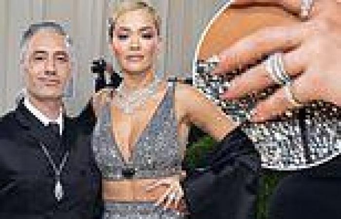 Rita Ora flashes a sparkling silver band on her engagement finger