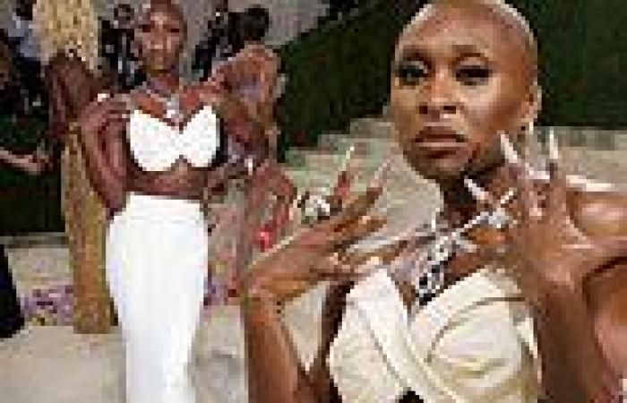 Cynthia Erivo puts her toned midriff on display in a white Moschino skirt and ...