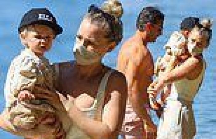 Anna Heinrich and Tim Robards enjoy a family day at the beach with their ...