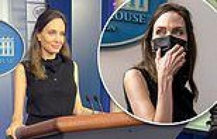 Angelina Jolie poses for pictures at Jen Psaki's lectern during surprise White ...