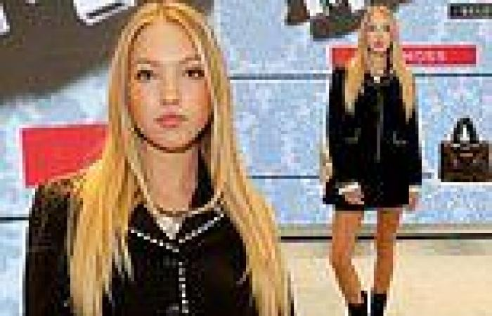 Lila Moss cuts a sophisticated figure in a bejewelled ensemble as she hosts the ...