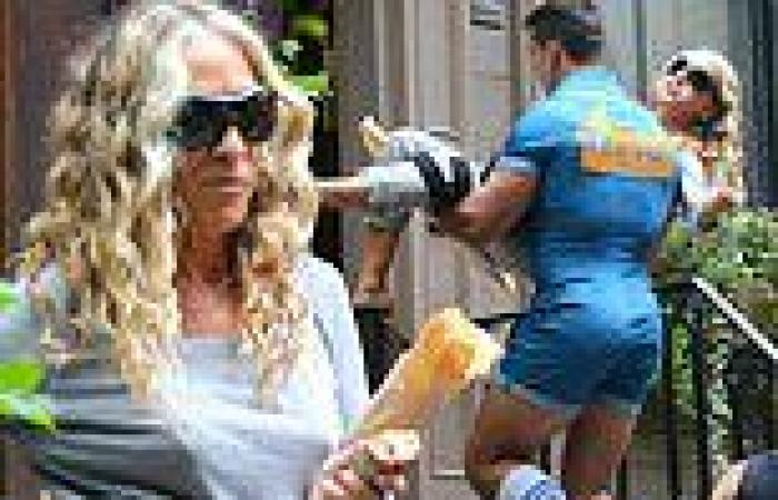 Sarah Jessica Parker gets scooped up in the muscled arms of a 'hot fella' in ...
