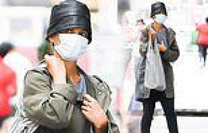 Katie Holmes goes incognito as she steps out in a black bucket hat while ...
