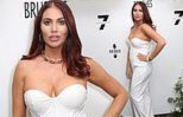 TOWIE's Amy Childs puts on a busty display in a white strapless jumpsuit at ...