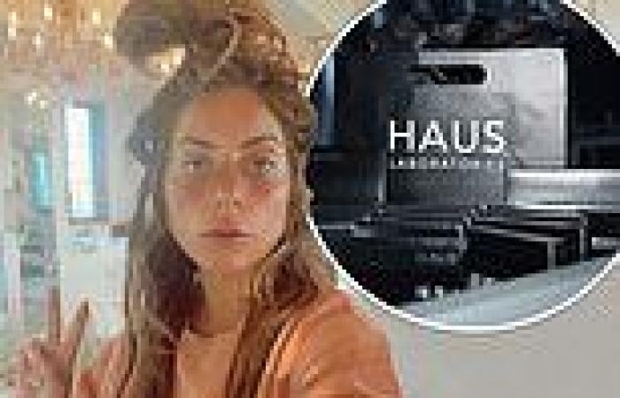 Lady Gaga exhibits a bedhead hairdo and flashes a peace sign while celebrating ...