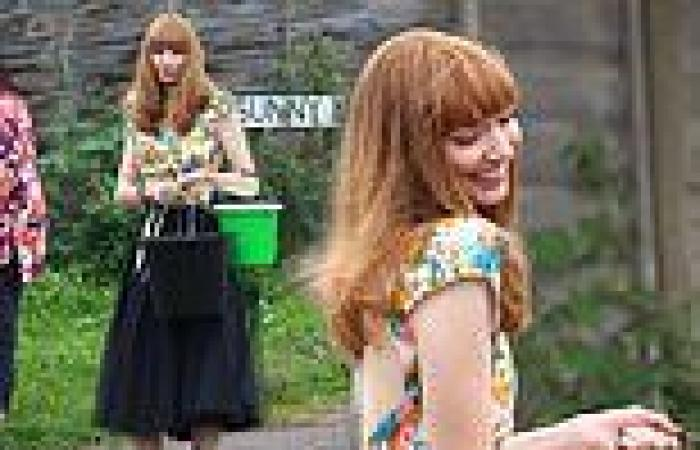 Eleanor Tomlinson looks stylish in floral top and black tulle skirt