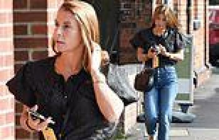 Coleen Rooney steps out sporting perfectly blow-dried mane after salon visit
