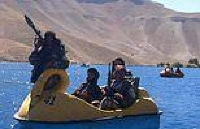 Armed Taliban fighters ride PEDALOS on lake in Afghanistan national park
