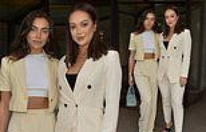 Francesca Allen and Sharon Gaffka wear suits as they leave WOTC magazine event