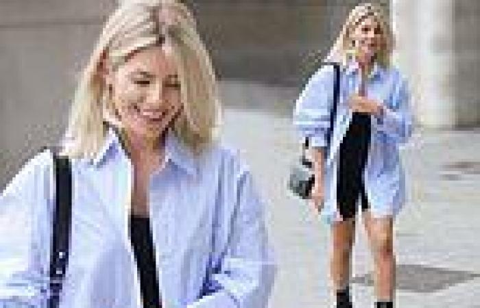 Mollie King looks leggy in a skintight unitard and billowing shirt