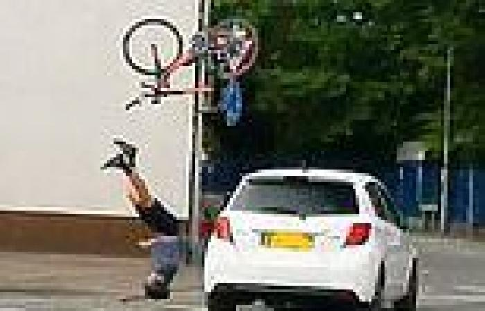 Terrifying moment cyclist, 27, was sent flying into the air after being hit by ...