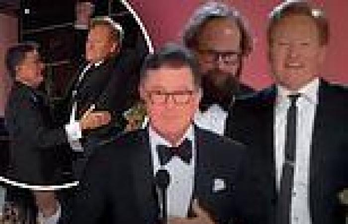 Conan O'Brien storms the Emmy stage as Stephen Colbert wins