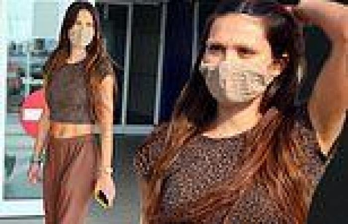 Amelia Hamlin shows off taut midriff strutting around Milan for Fashion Week