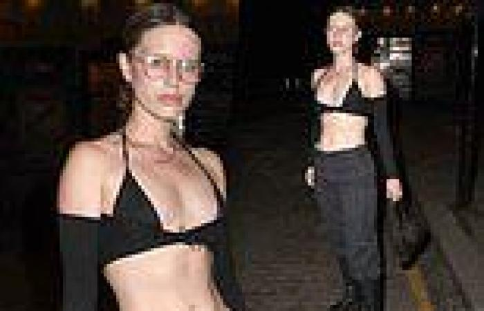 Amelia Hamlin showcases her toned midriff in plunging crop top during London ...
