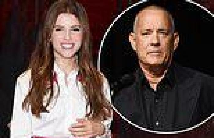 Anna Kendrick looks stylish in pink satin skirt as she joins a shaven-headed ...