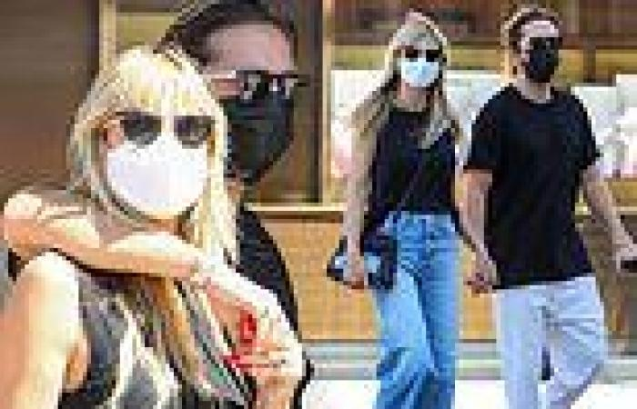 Heidi Klum rocks jeans and a tank top while shopping with husband Tom Kaulitz ...