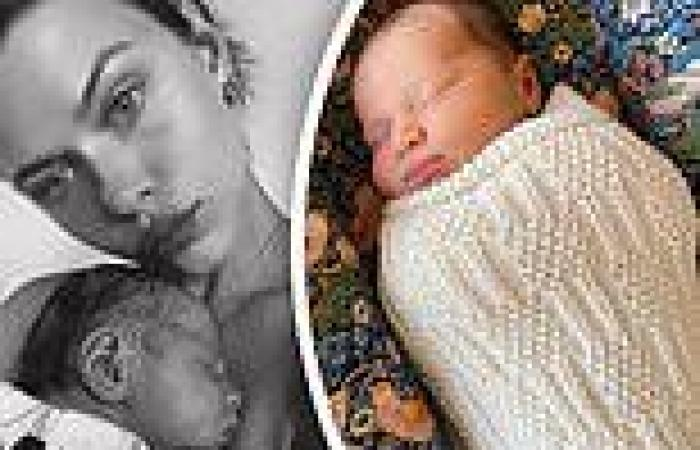 Victoria's Secret model Georgia Fowler kisses her newborn daughter