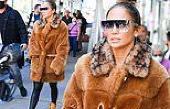 JLo dresses for fall in oversized plush coat as she steps out in NYC ahead of ...