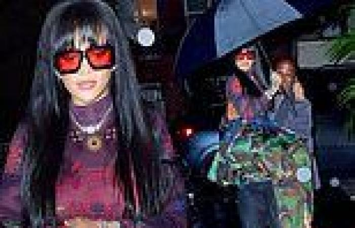 Rihanna rocks a camouflage skirt over matching pants as her bodyguard CARRIES ...