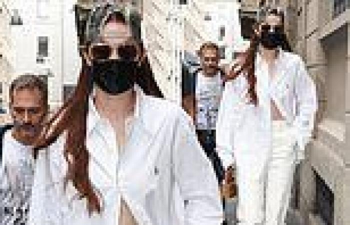 Gigi Hadid flashes her abs in a white Ralph Lauren shirt for Milan Fashion Week