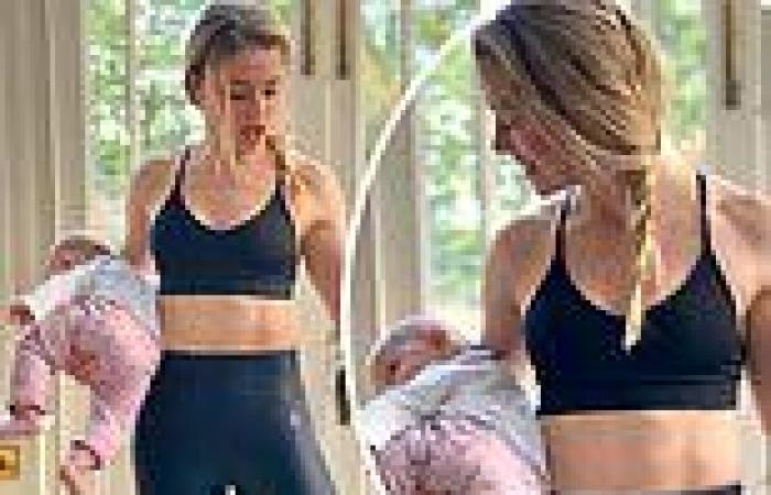 Amber Heard declares herself a 'multitasking mama' as she pumps iron and holds ...